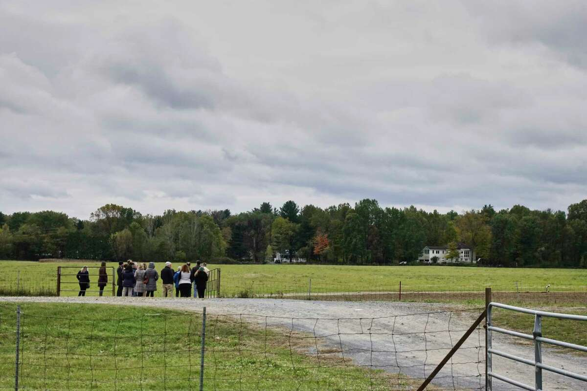 Visitors take a tour following a press conference at the Pitney Meadows Community Farm on Monday, Oct. 22, 2018, in Saratoga Springs, N.Y. The press conference was held to announce the Farmland for a New Generation New York program. (Paul Buckowski/Times Union)