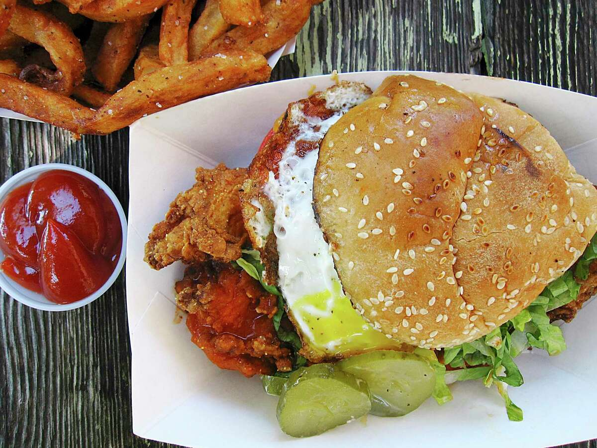 """The Luxury,103 E. Jones Ave """"It's really more like a giant chicken fried steak laid over a bun. It's got this really nice buffalo sauce on top of it. That is a chicken sandwich, because it has elements: lettuce and tomatoes and that sauce and it's giant and you've got that setting."""" - Mike Sutter"""