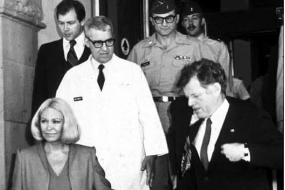 Dr. Basil Pruitt (in white coat) escorts U.S. Sen. Ted Kennedy, D-Mass., and his wife Joan Kennedy to make rounds at the burn center in San Antonio following the ill-fated attempt to rescue U.S. hostages in Iran in the spring of 1980.