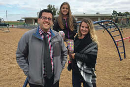 Pictured are, from left, Hamel Elementary School Principal Matt Sidarous, Olivia Scheller and Janet Scheller.