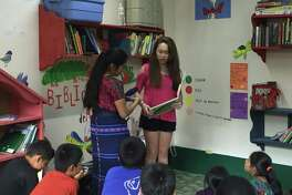 Susan Soh, 17, was named one of the 2018 National Gold Award Girl Scouts for her work to improve literacy rates in Guatemala through creating and stocking an audiobook library in Santa Maria de Jesus. Here, Soh (right) and Teacher Ana Hernandez read to students at SANA clinic, preschool and library in Santa Maria.