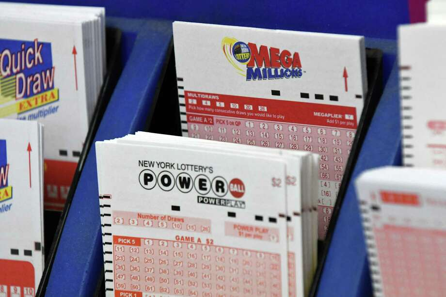 Mega Millions and Powerball forms are displayed at Coulson's News in Newton Plaza on Monday, Oct. 22, 2018, in Colonie, N.Y. The current prize for Tuesday's Mega Millions drawing is $1.6 billion. Wednesday's Powerball jackpot is $620 million. (Will Waldron/Times Union) Photo: Will Waldron, Albany Times Union