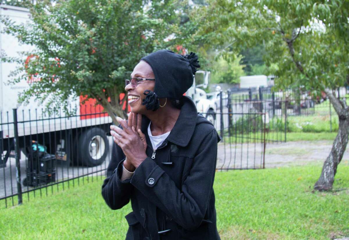 Independence Heights resident Elizabeth Moody smiles as a Conn's HomePlus truck delivers a new refrigerator and furniture to her home. The items were part of a $18,000 donation from Conn's in partnership with Rebuilding Together Houston to furnish three homes of families impacted by Hurricane Harvey.