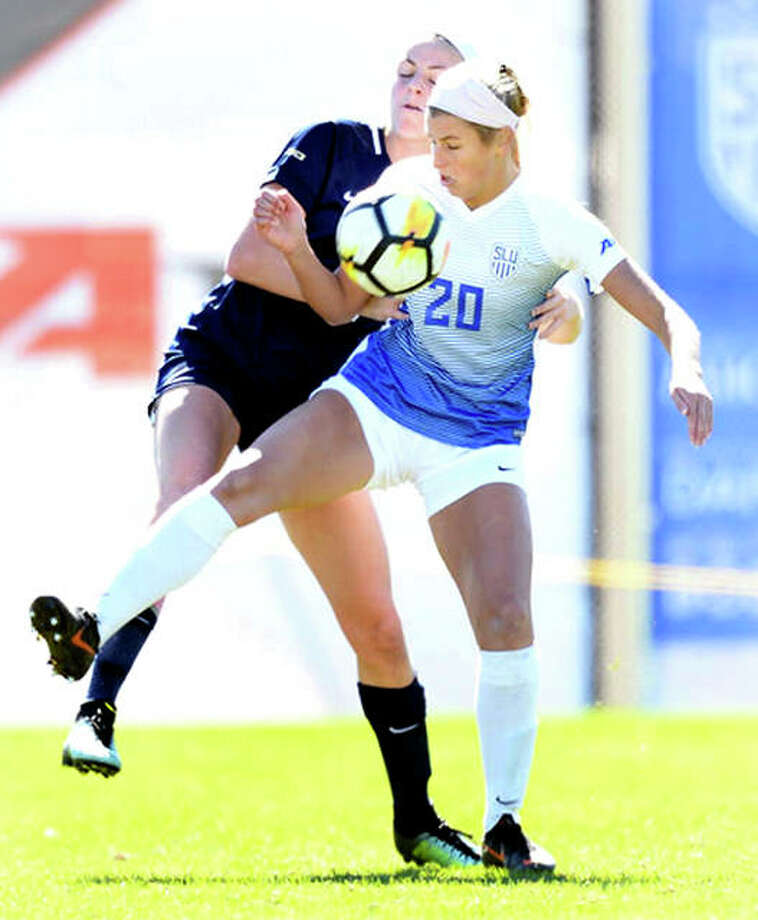 Saint Louis University's Annabelle Copeland 920) looks to settle the ball while being marked by a George Washington University player during Sunday's Atlantic 10 Conference game at Hermann Stadium. Copeland is a sophomore from Marquette Catholic High School. Photo: SLU Athletics