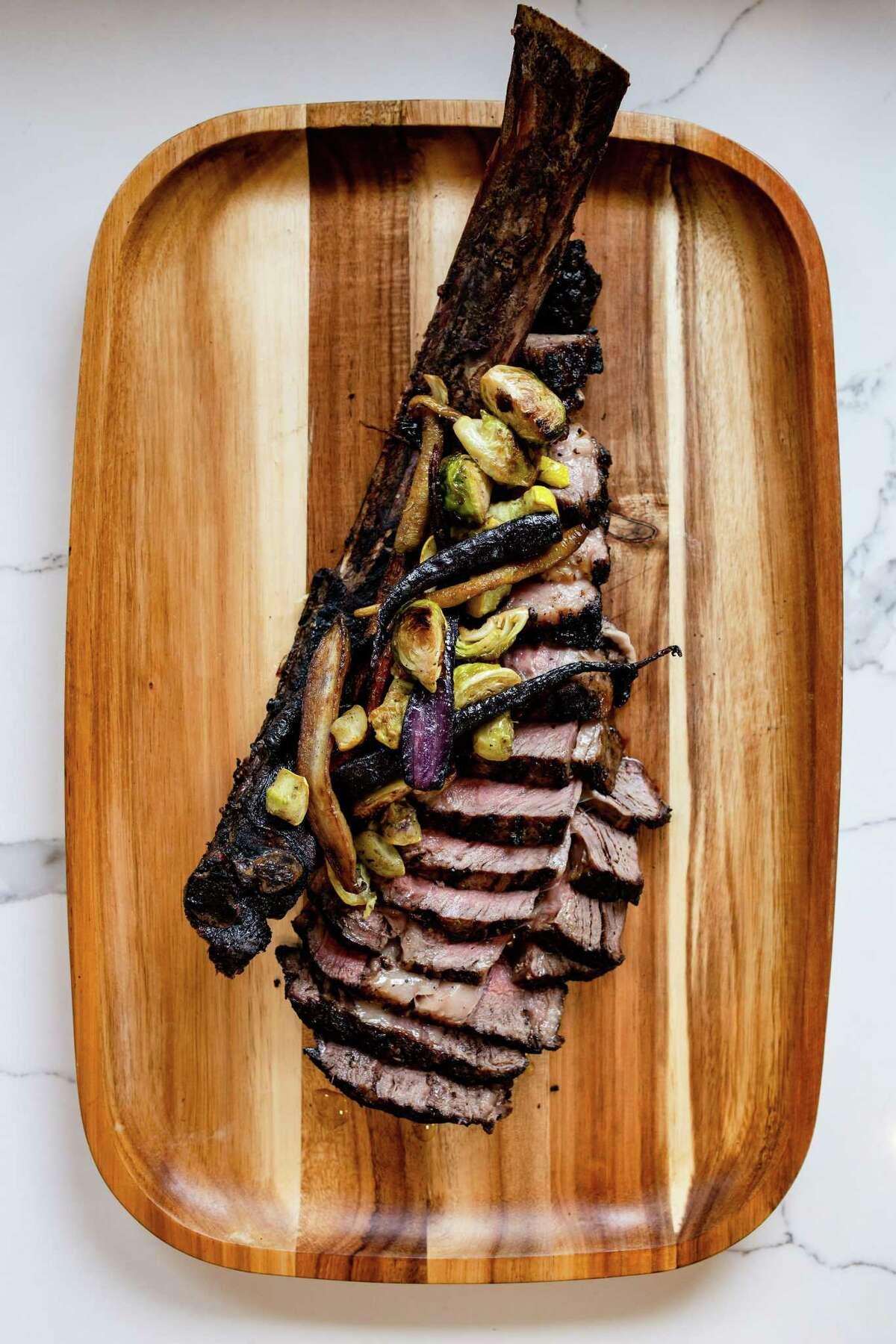 Tomahawk riveye a la Fiorentina (stea with rosemary, garlic, olive oil, lemon zest and Maldon salt) at Bisou.