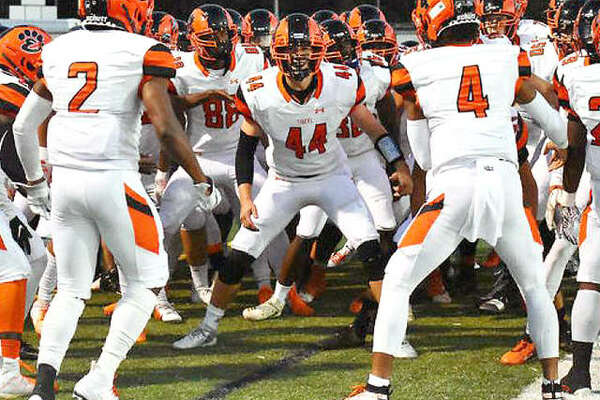 The Edwardsville Tigers will begin the Class 8A playoffs at 7 p[.m. Friday in Evanston against the Wildkits. EHS players are shown prior to a game against O'Fallon earlier this season.