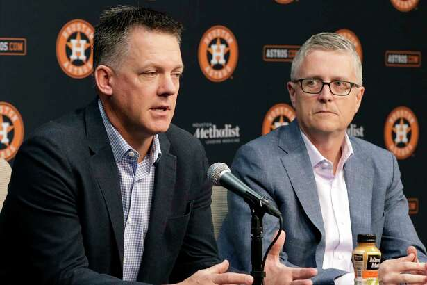 Houston Astros Manager A.J. Hinch, left, speaks during a press conference as President of Baseball Operations and General Manager Jeff Luhnow, right, listens at Minute Maid Park Monday, Oct. 22, 2018 in Houston, TX.at Minute Maid Park Monday, Oct. 22, 2018 in Houston, TX.