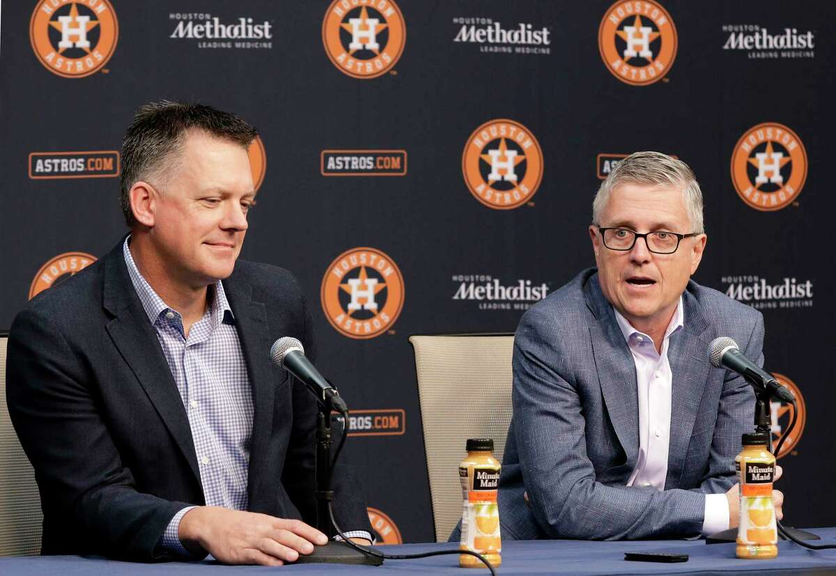Houston Astros President of Baseball Operations and General Manager Jeff Luhnow, right, speaks during a press conference as Manager A.J. Hinch, left, listens at Minute Maid Park Monday, Oct. 22, 2018 in Houston, TX.at Minute Maid Park Monday, Oct. 22, 2018 in Houston, TX.