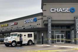 Harris County sheriff's deputies say a man used pepper spray to rob an armored car at a Chase Bank near Cloverleaf about 10:50 a.m. Monday.