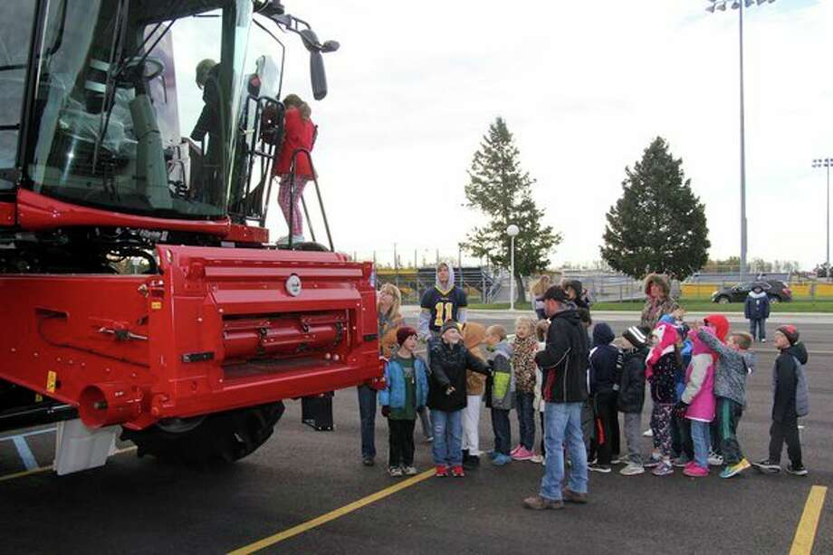 Bad Axe Elementary students enjoyed a Down on the Farm Day, Friday morning. At the event, students toured different stations, which featured farm equipment, various food and animal food products, livestock, and poultry. (Seth Stapleton/Huron Daily Tribune)