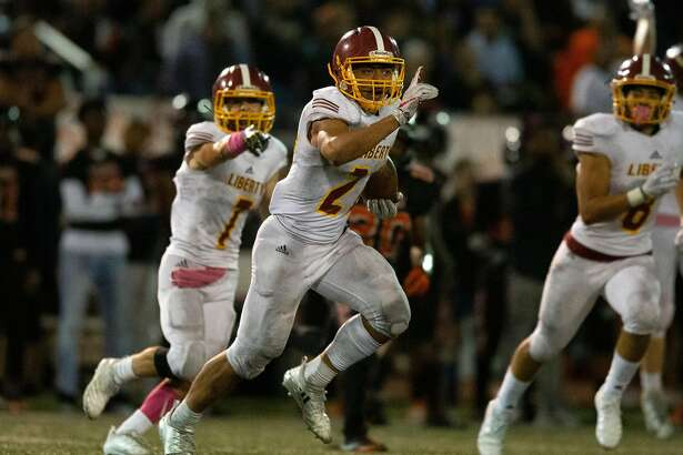 Liberty's Sione Vaki (22) celebrates after intercepting a pass by Pittsburg's Willie Harts III (3) to clinch the Lions' 24-21 victory, during the fourth quarter of a high school football game, on Friday, Oct. 19, 2018 in Pittsburg, Calif.