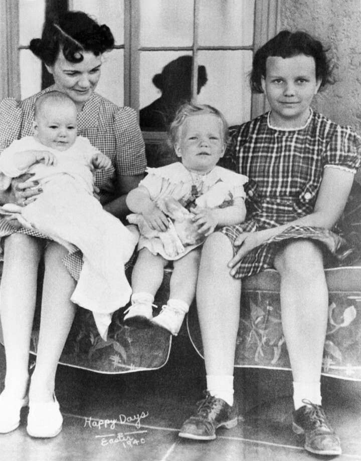 Sandra Day O'Connor (right) is shown in family album picture from Easter 1940, taken on family ranch. Her mother, Ada Mae Day, holds brother Alan, who now runs the ranch. Sister Ann is in middle. President Reagan has nominated Mrs. O'Connor to the U.S. Supreme Court. Photo: Bettmann/Bettmann Archive