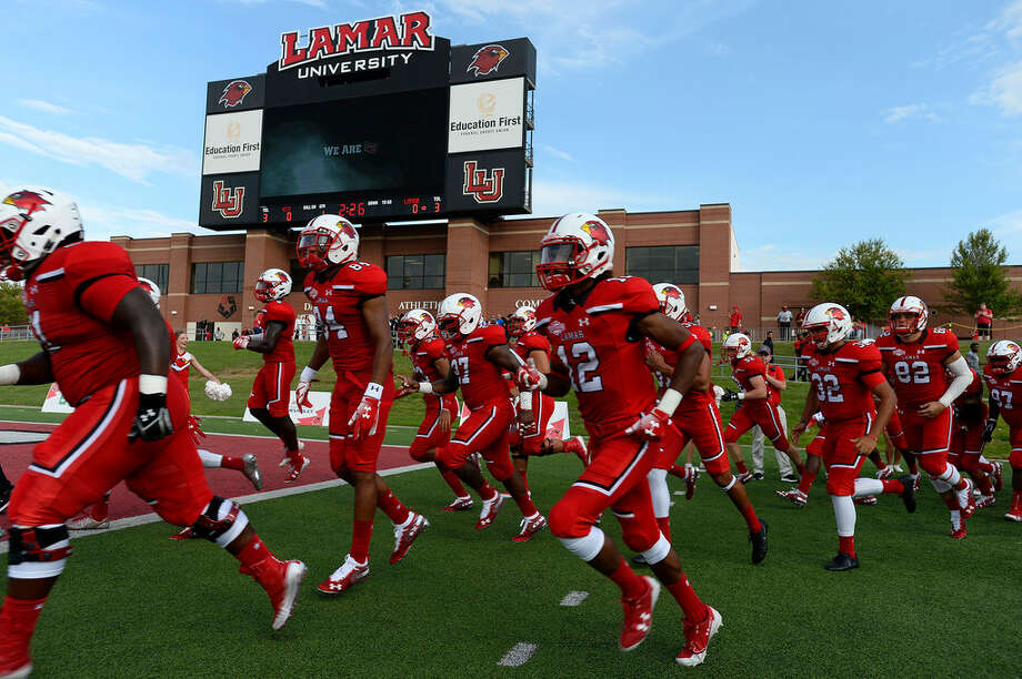 Lamar players run onto the field to play against Kentucky Christian in their season opener at Provost-Umphrey Stadium. 