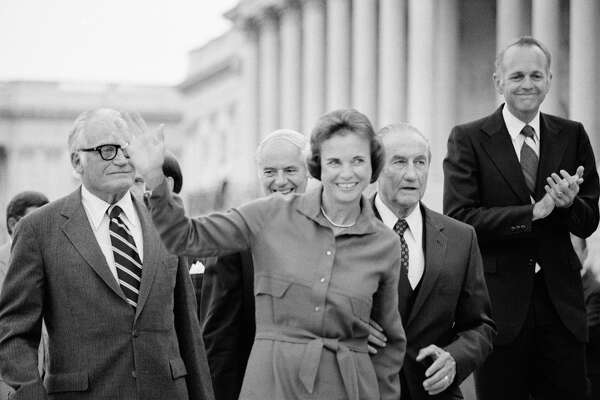 FILE - Sandra Day O'Connor waves as she arrives at the U.S. Capitol in Washington in Sept. 1981, shortly after her nomination to the Supreme Court is confirmed by the Senate. Walking behind O'Connor are, from left, Sen. Barry Goldwater, R-Ariz., Attorney General William French Smith, Sen. Strom Thurmond, R-S.C., who chairs the Senate Judiciary Committee, and Sen. Dennis DeConcini, D-Ariz. (AP Photo/Scott Applewhite)