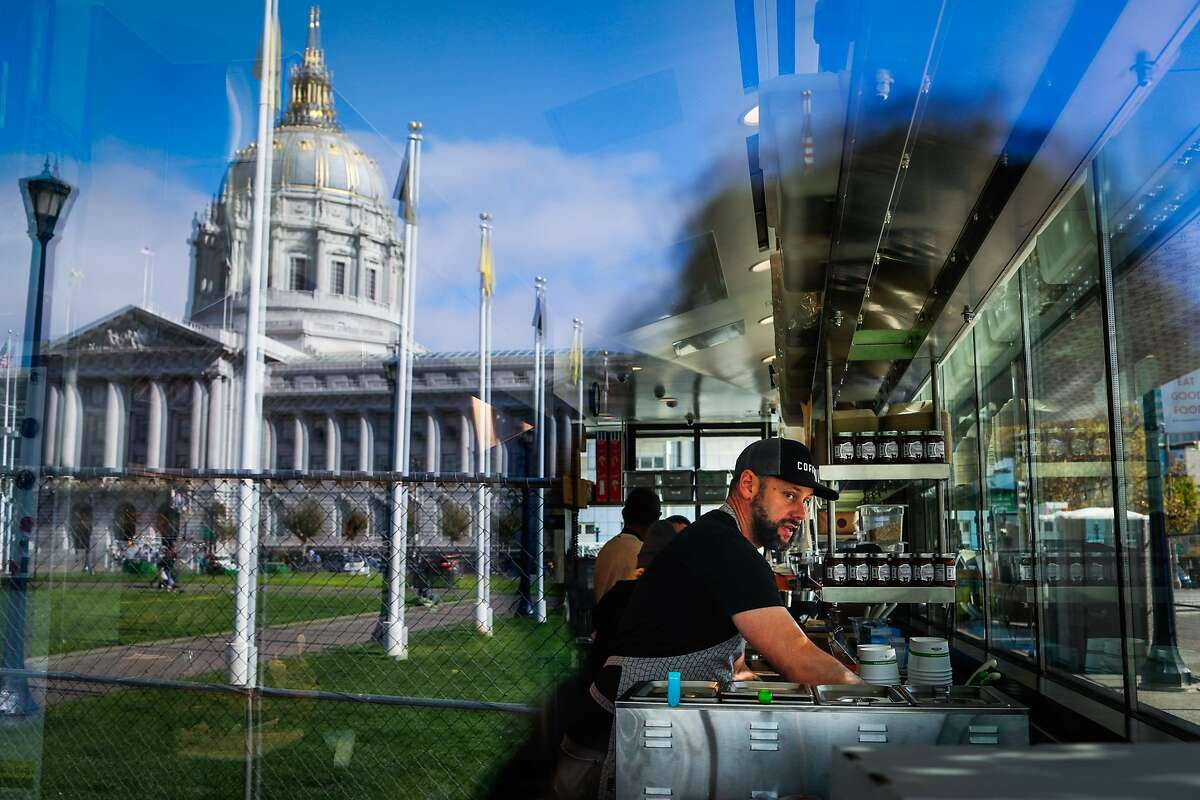 Jason Rose, a Bi-Rite cafe employee works at the cafe to get it ready a few days before it opens at Civic Center.