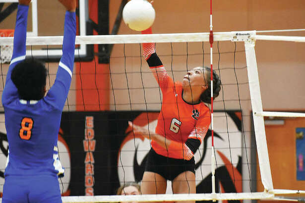 Edwardsville's Alexa Harris slams down a kill during a regular season match against East St. Louis inside Lucco-Jackson Gymnasium.