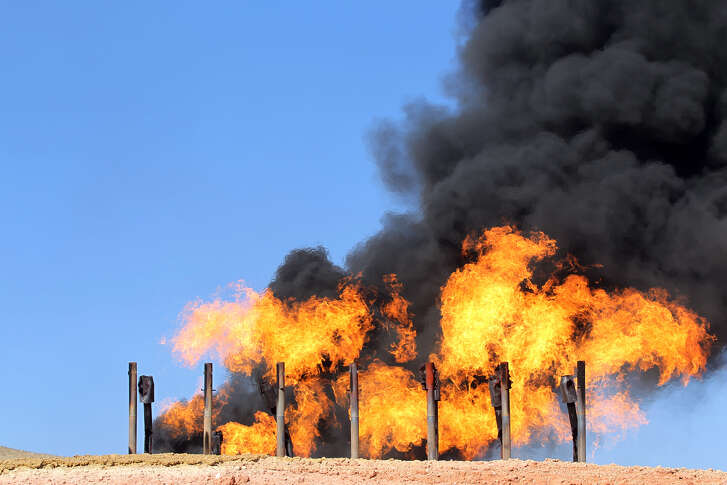 A picture taken on October 17, 2017 shows excess flammable gasses burning from gas flares at the Havana oil field, west of the multi-ethnic northern Iraqi city of Kirkuk. Iraqi forces took control of the two largest oil fields in the disputed northern province of Kirkuk demolishing Kurdish hopes of creating a viable independent state. / AFP PHOTO / AHMAD AL-RUBAYE (Photo credit should read AHMAD AL-RUBAYE/AFP/Getty Images)