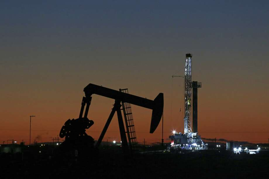 In this Tuesday, Oct. 9, 2018, photo, an oil rig and pump jack are at work as seen from the roadside of FM 1788 in Midland, Texas.  CONTINUE to see scenes from the 2018 Permian Basin International Oil Show. Photo: Jacob Ford, Associated Press