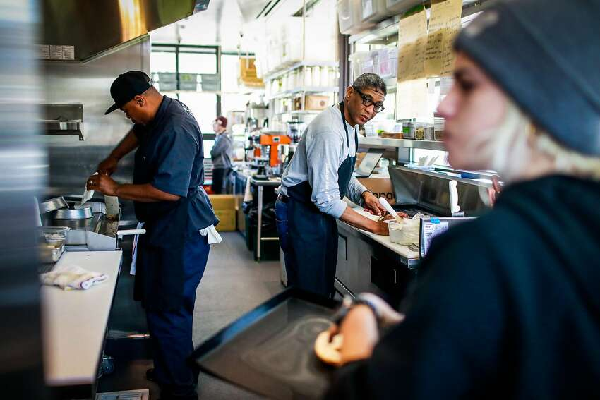 (l-r) Ken Johnson, Tim Ross and Nina Solinas work to get the Bi-Rite cafe up and running just three days before the cafe opens at Civic Center in San Francisco, California, on Sunday, Oct. 21, 2018.