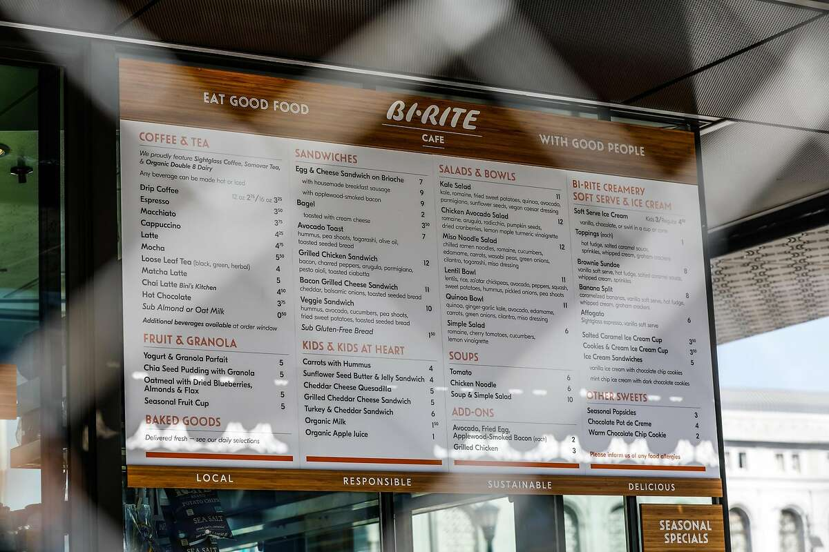 The Bi-Rite cafe menu is seen through a fence, just days before it opens in Civic Center in San Francisco, California, on Sunday, Oct. 21, 2018.