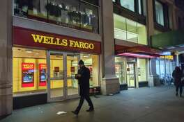 Wells Fargo will pay $65 million to the state of New York, after an investigation by federal authorities and the state attorney general over cross-selling practices the banking giant employed.