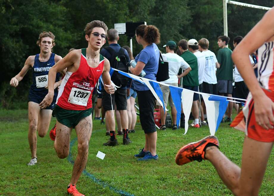 In this file photo, The Woodlands' Spencer Cardinal (1237) and Kingwood's Carter Storm (585) compete during the Varsity Boys race at the Andy Wells Invitational at Kingwood High School on Sept. 15, 2018. Photo: Jerry Baker, Houston Chronicle / Contributor / Houston Chronicle