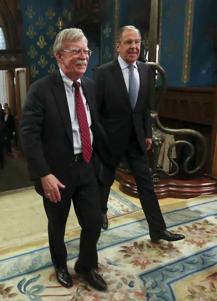 U.S. National Security Adviser John Bolton, left, and Russian Foreign Minister Sergey Lavrov enter a hall for their talks in Moscow, Russia, Monday, Oct. 22, 2018. President Trump's national security adviser has met with top Russian officials after Trump declared he intended to pull out of a 1987 nuclear weapons treaty.