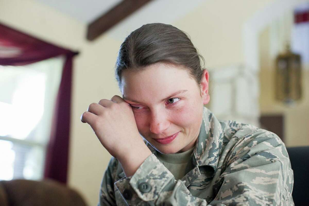 Airman Basic Victoria Cannon wipes a tear after seeing her husband via videoconference at the home of Mark and Barbara Bean for the first time since she started basic training in 2014. The Beans were participating in Operation Home Cooking, where local families volunteer to take in Lackland airmen for Thanksgiving Day.