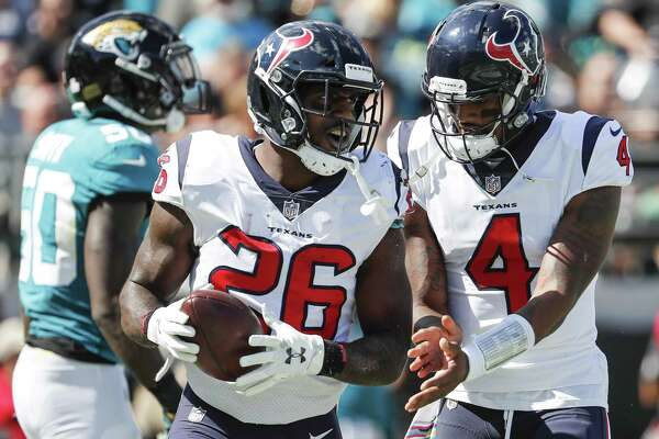 Houston Texans running back Lamar Miller (26) and quarterback Deshaun Watson (4) celebrate Miller's 5-yard touchdown run against the Jacksonville Jaguars during the second quarter of an NFL football game at TIAA Bank Field on Sunday, Oct. 21, 2018, in Jacksonville.