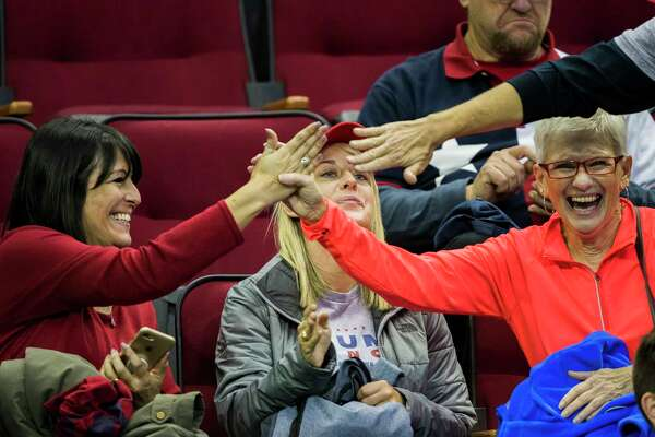 President Donald Trump supporters cheer as they seat in the Toyota Center for the MAGA Rally where the president will address the crowd, Monday, Oct. 22, 2018, in Houston.