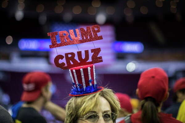 A supporter wears a Trump Cruz hat to the MAGA Rally in the Toyota Center, Monday, Oct. 22, 2018, in Houston.