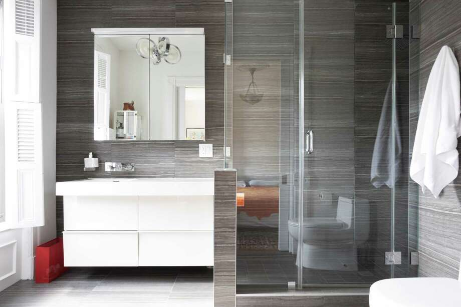 Floating vanities, attached to the wall so they appear to be hovering above the floor, look sleek and efficient, which is why they work best in contemporary baths, as opposed to transitional or even traditional bathrooms. Floating vanities also free up floor space and make cleaning underneath them much easier. Photo: HGTV.com