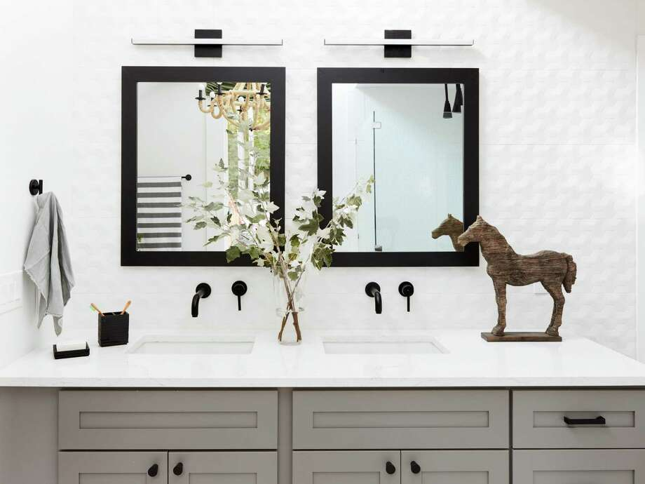 Some 66 percent of master bathrooms remodeled in 2018 have two sinks. Also, gray was a popular paint color choice for cabinets, with 16 percent of homeowners choosing it. Photo: HGTV.com, Commissioned Photographer / © 2018, HGTV/Scripps Networks, LLC. All Rights Reserved.