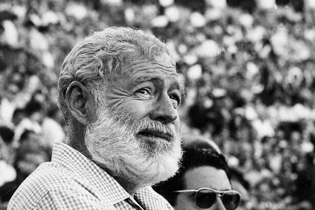 """FILE - In this Nov. 1960 file photo, U.S. novelist Ernest Hemingway attends a bullfight in Madrid, Spain. Two Ernest Hemingway stories written in the mid-1950s and rarely seen since will be published next year. The director of Hemingway's literary estate, Michael Katakis, told The Associated Press recently that """"The Monument"""" and """"Indian Country and the White Army"""" will be included with a reissue of the author's classic """"For Whom the Bell Tolls."""" (AP Photo/File)"""