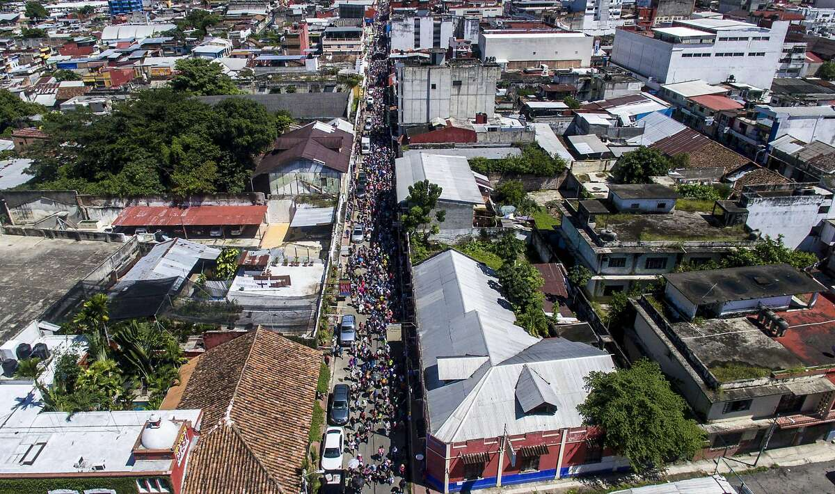 Aerial view of Honduran migrants heading in a caravan to the US, in Tapachula, Chiapas state, Mexico on October 22, 2018. - Honduran migrants heading in a caravan to the US, rest alongside the route, in Metapa, Chiapas state, Mexico on October 22, 2018. (Photo by PEDRO PARDO / AFP)PEDRO PARDO/AFP/Getty Images