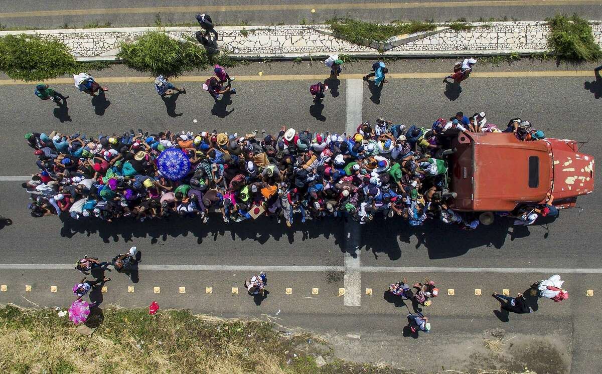 Aerial view of Honduran migrants onboard a truck as they take part in a caravan heading to the US, in the outskirts of Tapachula, on their way to Huixtla, Chiapas state, Mexico, on October 22, 2018. - President Donald Trump on Monday called the migrant caravan heading toward the US-Mexico border a national emergency, saying he has alerted the US border patrol and military. (Photo by PEDRO PARDO / AFP)PEDRO PARDO/AFP/Getty Images