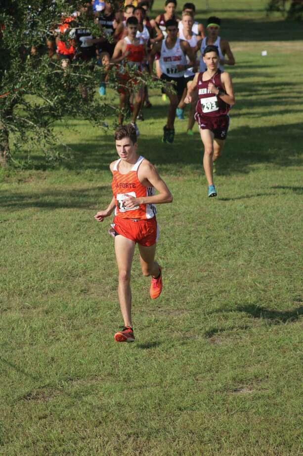 Ryan Schoppe, shown building his lead at the 21-6A race Oct. 11, captured the Region III championship Monday morning with the time of 15:29.1. The former Fairmont Junior High student defeated Kingwood's Carter Storm for the crown. Photo: Robert Avery