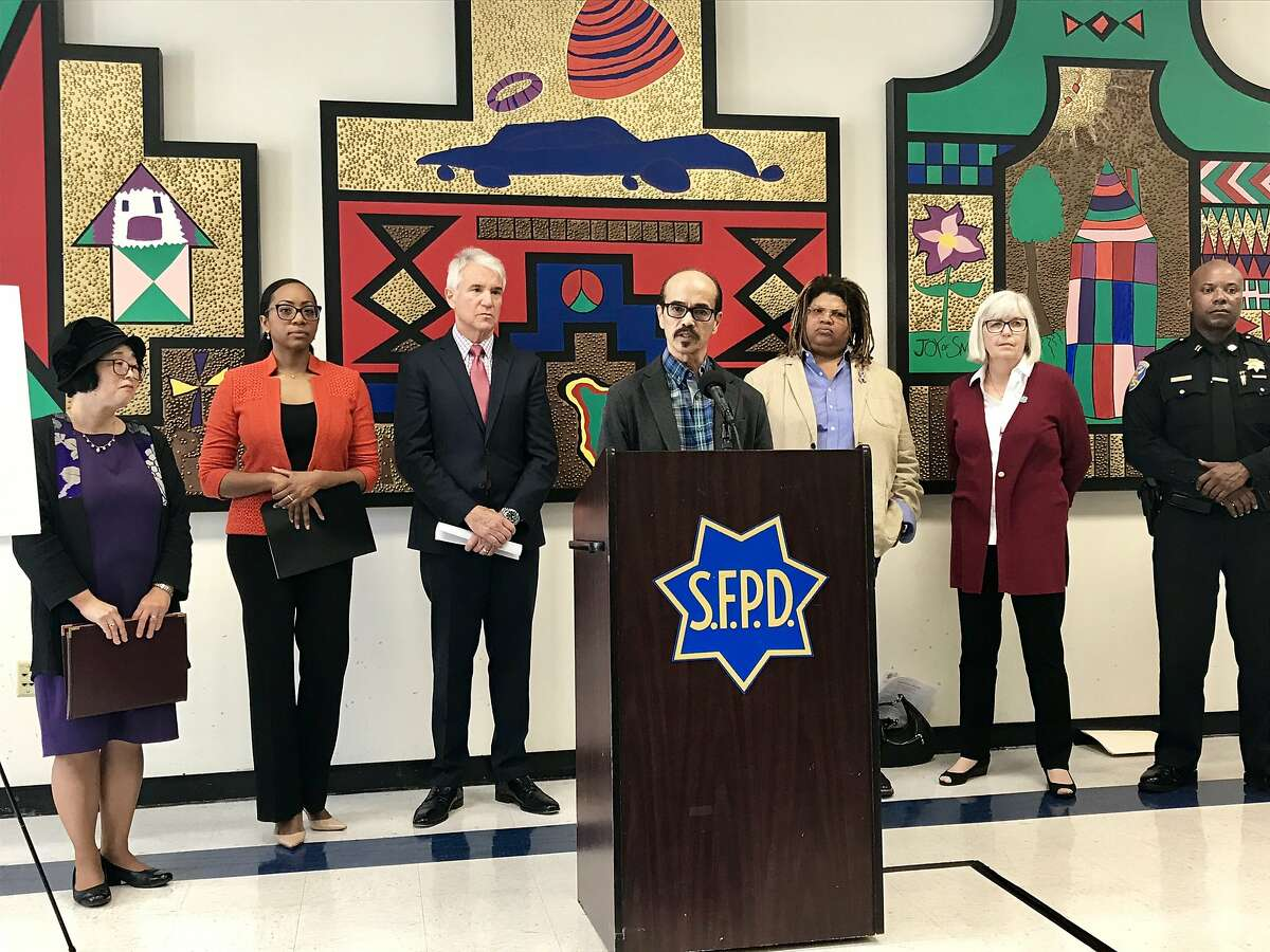 Dr. Emily Murase, Supervisor Malia Cohen, Attorney General George Gascón, Amor Santiago, Andrea Shorter, Kathy Black, and police Captain Steve Ford announce a grant to renew a domestic violence screening process in Bayview.