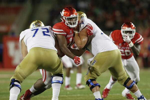 HOUSTON, TX - OCTOBER 04: Ed Oliver #10 of the Houston Cougars fights through the blocks of Tyler Bowling #72 of the Tulsa Golden Hurricane and Chandler Miller #74 in the first half at TDECU Stadium on October 4, 2018 in Houston, Texas. (Photo by Tim Warner/Getty Images)