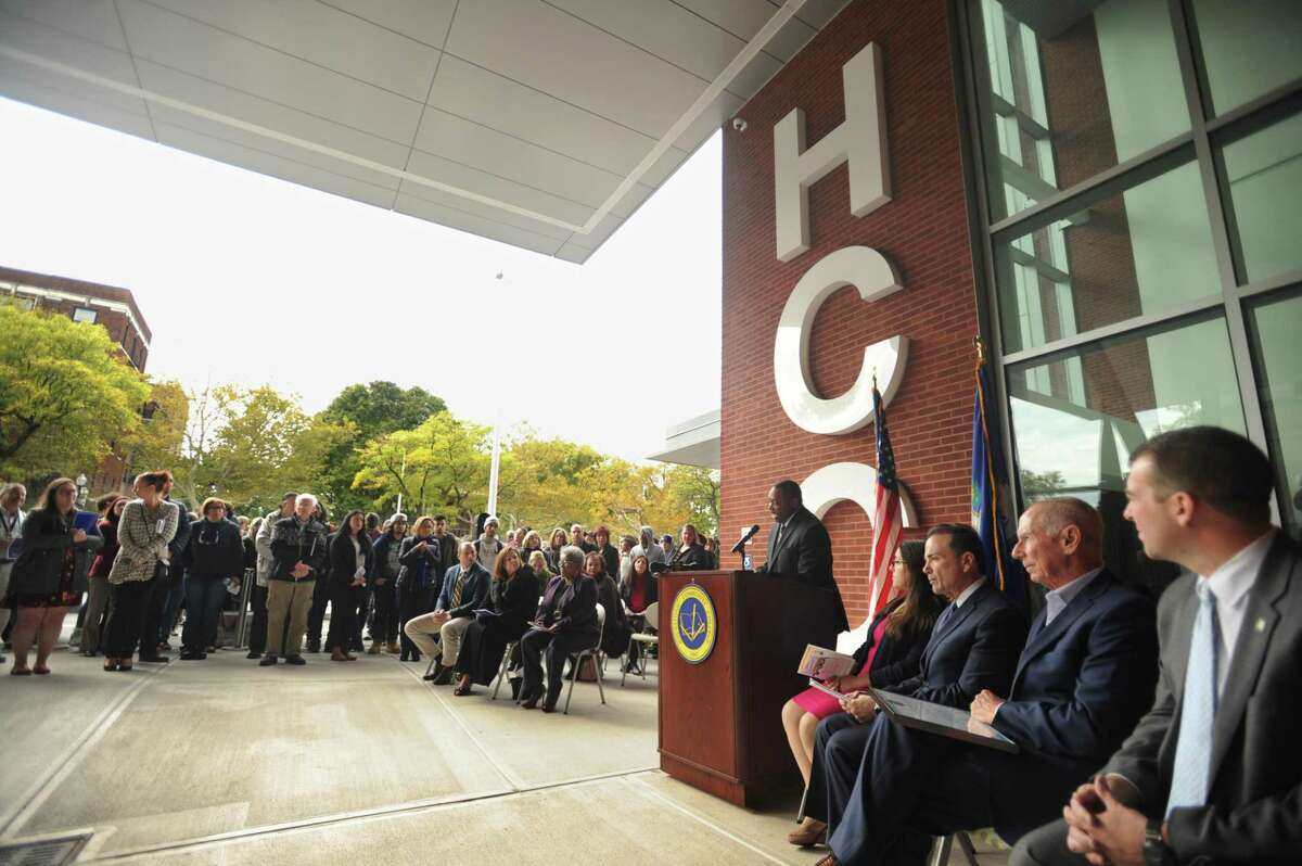 Housatonic Community College President Paul Broadie addresses the ribbon cutting ceremony for the school's Lafayette Hall expansion in Bridgeport, Conn. on Monday, October 22, 2018.