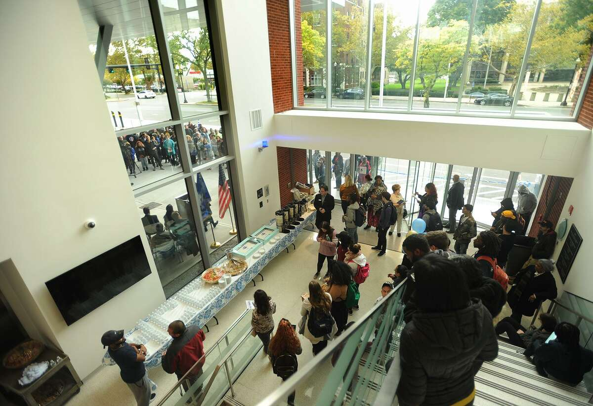 Housatonic Community College students watch from the atrium the ribbon cutting ceremony for the school's Lafayette Hall expansion in Bridgeport, Conn. on Monday, October 22, 2018.