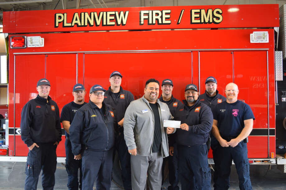 FF Mckinnon Walker, FF Blake Horton, Captain Harrison Hart, FF Lucas Johnson, DJ Perez, EO Ryan Seales, EO T.J. Marquez, FF Cary Smith, Lieutenant Bryan Merrick Photo: Ellysa Harris/Plainview Herald