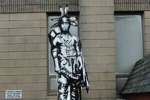 A statue honoring Norwalk's indigenous people, which was created by the artist 5iveFingaz, has found a new home outside the Norwalk Museum.