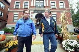 Ansonia Mayor David Cassetti (left) and Republican U.S. Senate candidate Matt Corey leave Ansonia City Hall on a walking tour of Main Street on October 22, 2018.