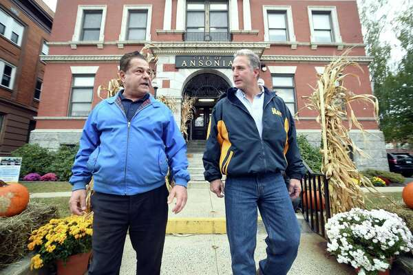 Ansonia Mayor David Cassetti (left) and Republican U.S. Senate candidate Matt Corey leave Ansonia City Hall on a walking tour of Main Street on October 22, 2018.