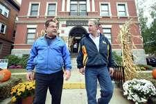 Ansonia Mayor David Cassetti, left, and Republican U.S. Senate candidate Matt Corey leave Ansonia City Hall on a walking tour of Main Street Monday.