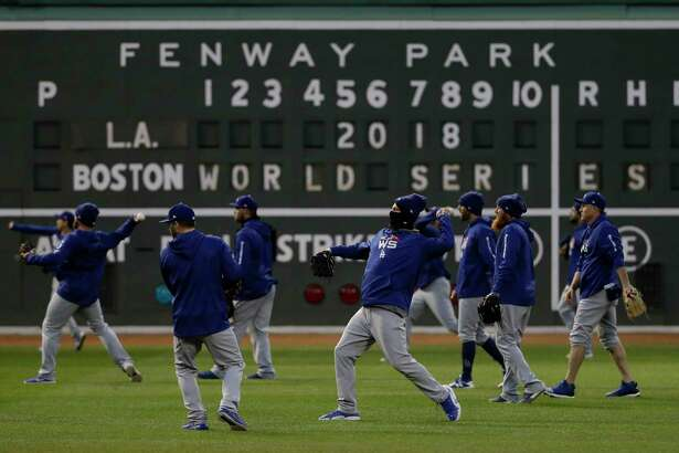 Los Angeles Dodgers' players practice for Game 1 of the World Series baseball game against the Boston Red Sox Monday, Oct. 22, 2018, in Boston.
