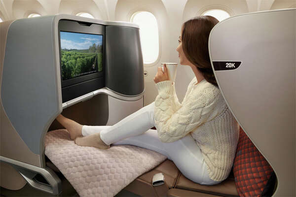 Road warriors want business class seats on flights of more than six hours.