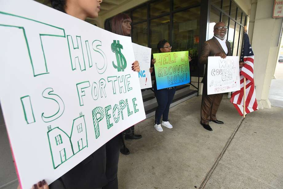 Lead by local activist Hilton Kelley, a small group protesters stand outside Port Arthur's city hall Monday in dissent of the city's recent decision to decline requesting $25,000,000 in Tropical Storm Harvey recovery funds. 