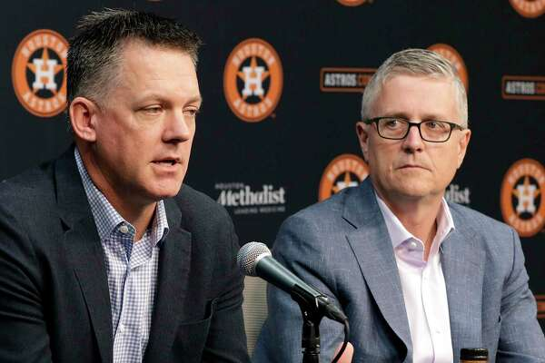 Astros Manager A.J. Hinch, left, and general manager Jeff Luhnow didn't go into specifics Monday about offseason moves.